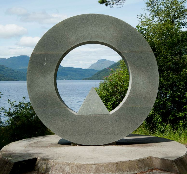 Close-up of an abstract, circular monument, overlooking Loch Lomond