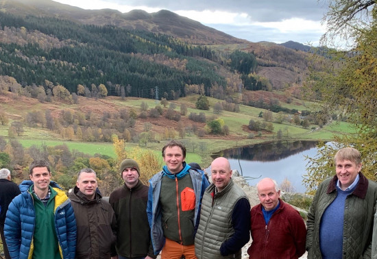 group of foresters standing against Perthshire backdrop