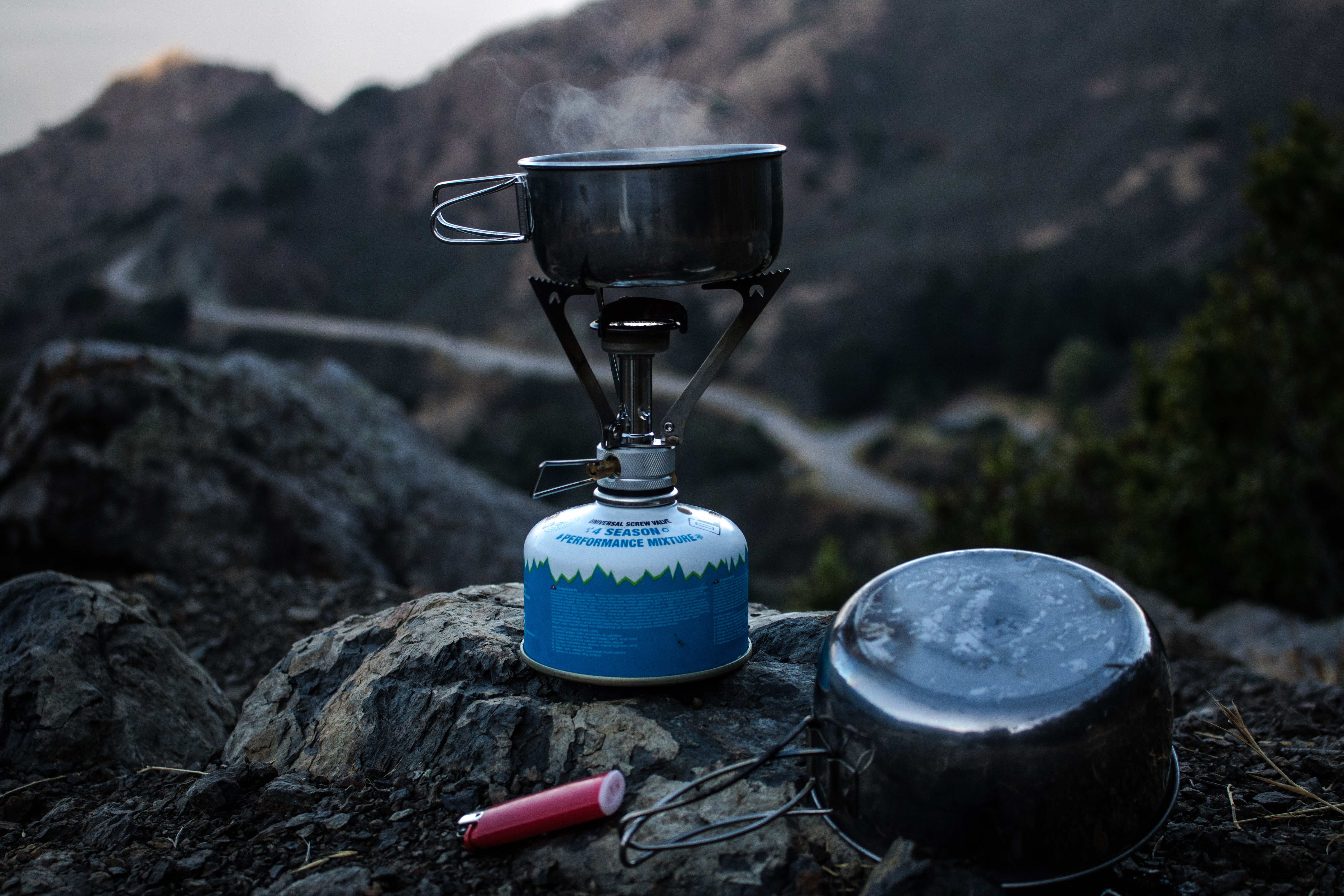 Lighter and gas stove with mountain in the background