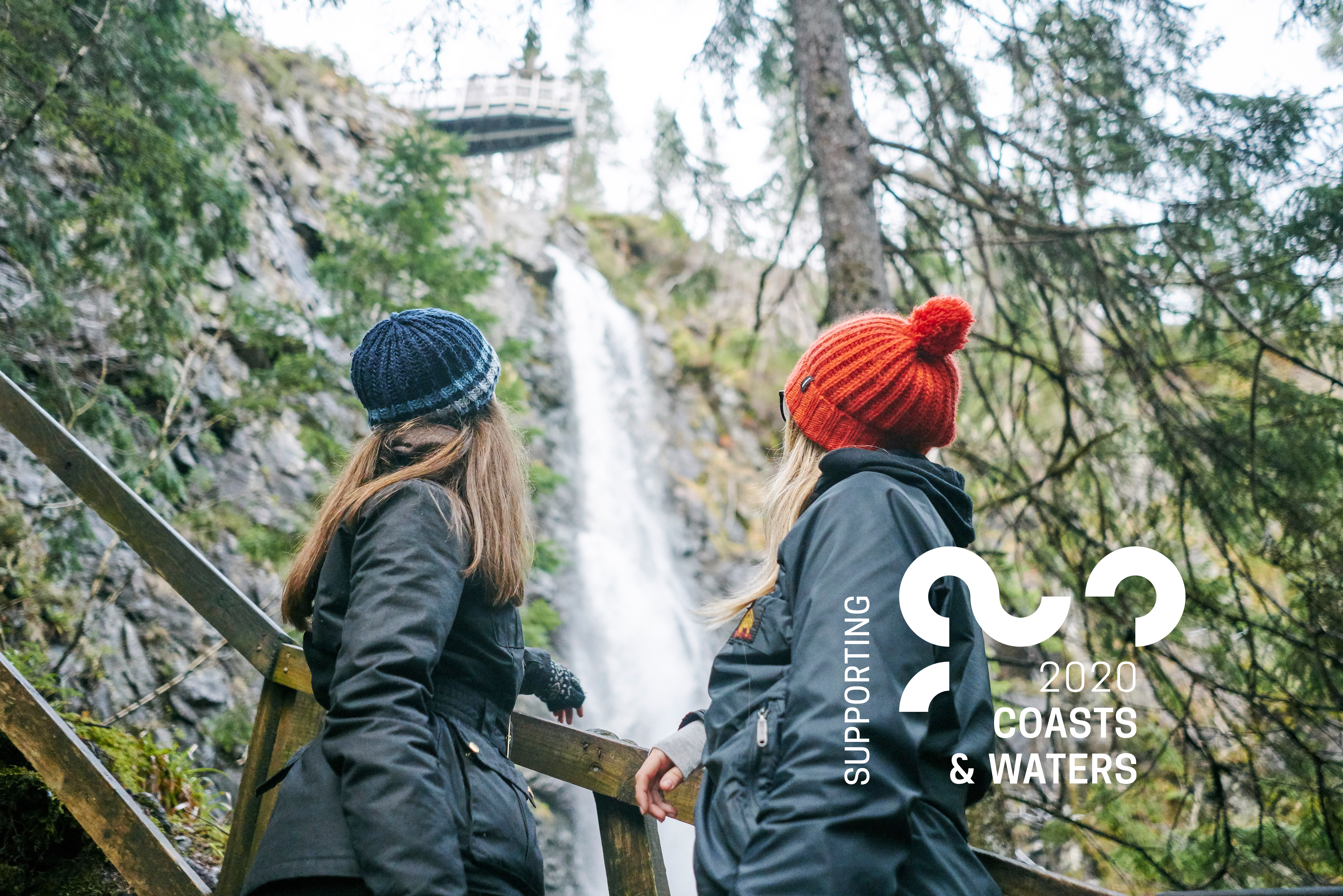 Two women looking at a waterfall in Glen Affric
