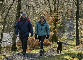 Couple walking their dog at Glentrool
