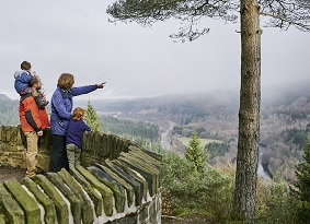 Family looking over forest from Craigvinean viewpoint