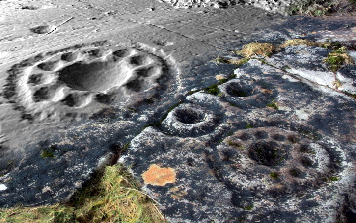 Close up of circular patterns in the rock art