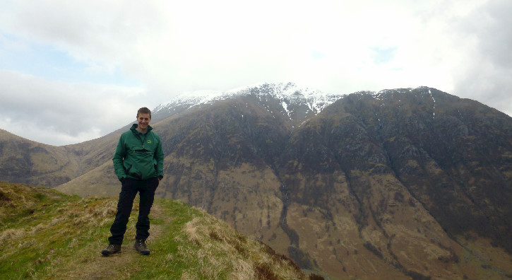 Ruari Watt standing in front of Ben Nevis