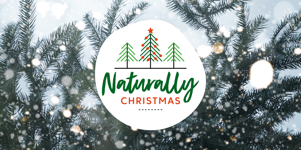 'Naturally Christmas' written over a photo of a Christmas tree branch