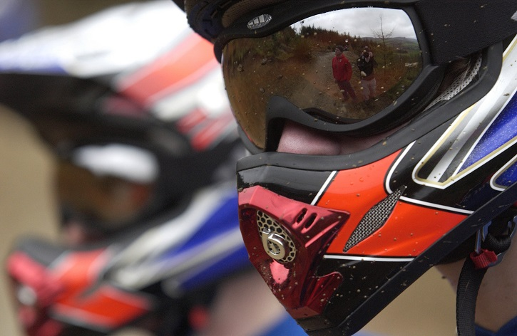 Close up of person wearing full face helmet and goggles