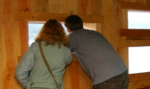 A couple looking out of a hatch at a wildlife hide