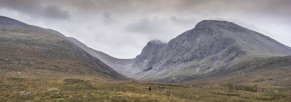 View up valley to forbidding grey cliffs of Ben Nevis