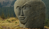 A boulder with a face carved into it