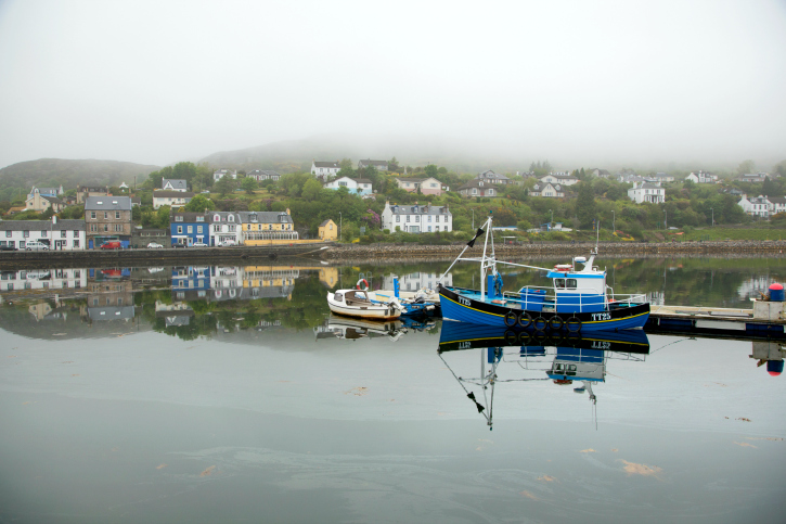 tarbert harbour with boats on foggy day