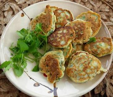 A plate of chickweed fritters and edible green leaves