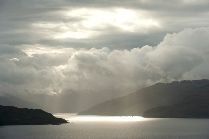 Skye sun coming through clouds at kinloch