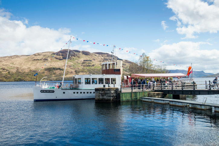 people boarding steamship on Loch Katrine